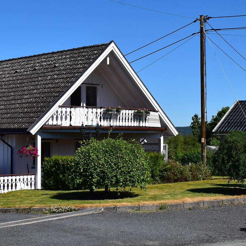 Hus tilknyttet strømnettet via strømledning